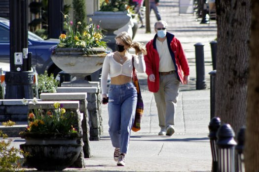 Residents wearing masks in downtown Lake Oswego, Ore., in early April. Oregon is lifting its indoor mask mandate for people who have been fully vaccinated against Covid-19.