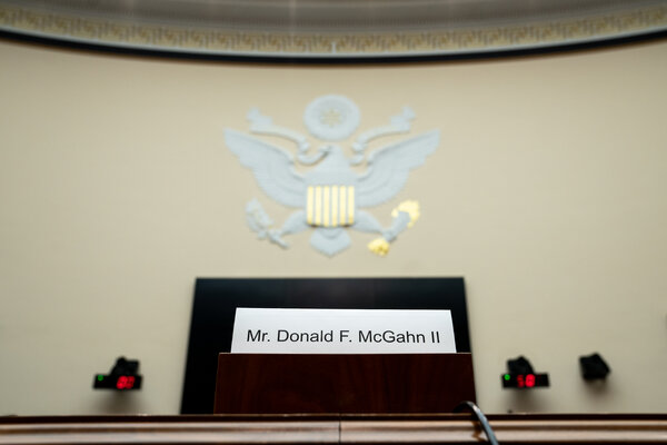 A name placard was displayed in front of an empty chair after President Donald J. Trump's former White House counsel did not show up for a congressional hearing in 2019.