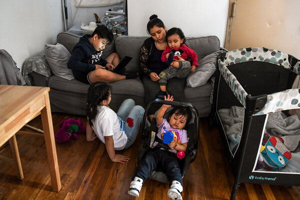 Isabel Galán, 31, and her children in the Mott Haven neighborhood of the Bronx last month.