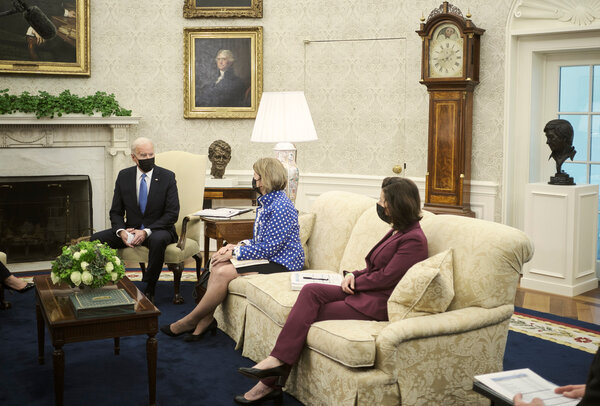 President Biden met with Republican senators, including SenatorShelley Moore Capito of West Virginia, center, and Commerce Secretary Gina M. Raimondo, right, this month  at the White House on infrastructure proposals.