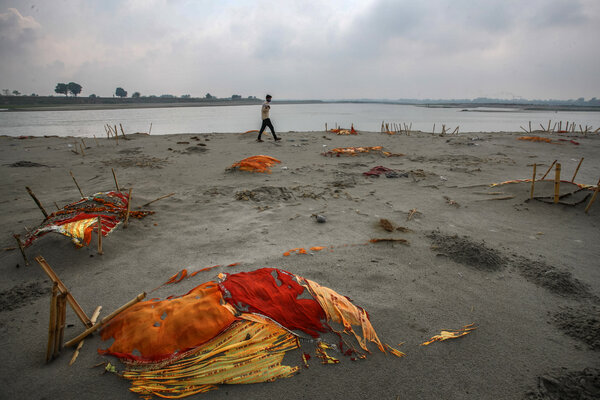 Bodies, some of which are believed to be Covid-19 victims, partly exposed in shallow sand graves on the banks of the Ganges River last week in Uttar Pradesh, India.