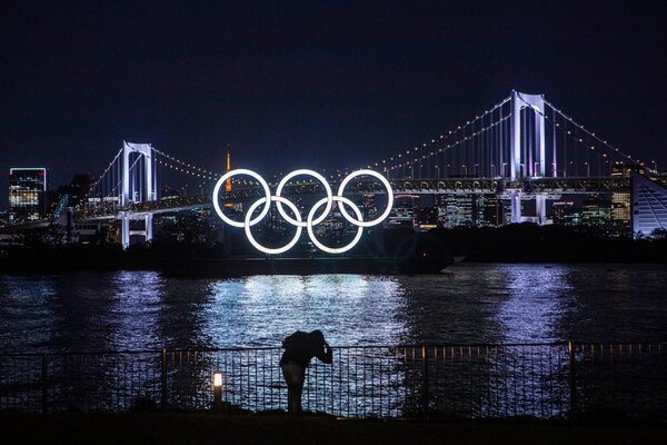 A set of Olympic rings illuminated a park in Tokyo last month.