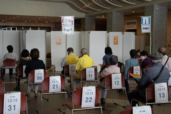 Older people waiting to receive a coronavirus vaccine in Tokyo on Monday.