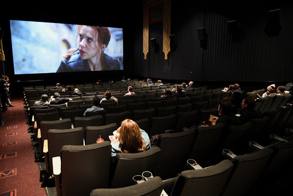 The audience at an AMC theater in Manhattan in March. Shares in AMC have risen sharply this week.