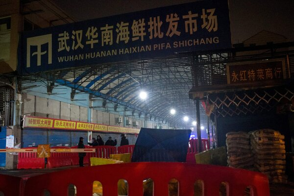 The entrance to a seafood and meat market in Wuhan, China. A prevailing theory of the virus's origin is that it jumped from animals to humans, possibly originating at the market, while another involves a lab accident.