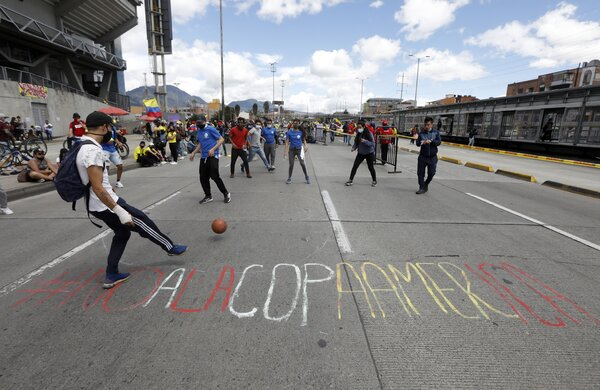 People gathered in front of theEl Campin stadium to protest holding the Copa America in Bogota, Colombia, earlier this month.