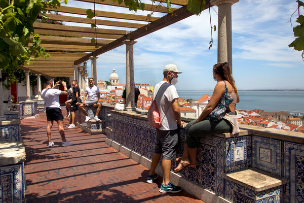 Tourists at the Santa Luzia Viewpoint in Lisbon last week.