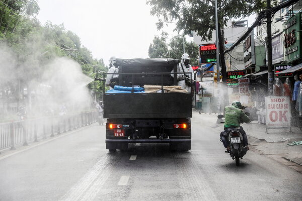 A truck spraying disinfectant in Ho Chi Minh City, Vietnam, on Tuesday. The government said it planned to test the city's nine million inhabitants for the coronavirus.