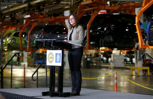Mary Barra, the chief executive of General Motors, at an assembly plant in Michigan last month. President Biden is seeking to reinstate Obama-era auto pollution restrictions to combat climate change.