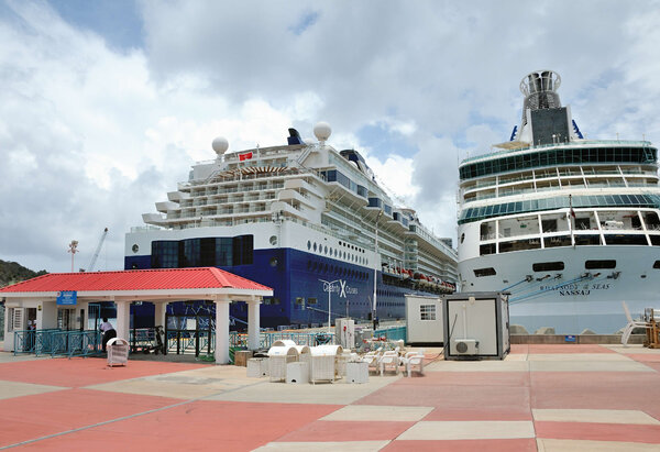 The Celebrity Millennium, left, docked on the island of St. Maarten, last week.