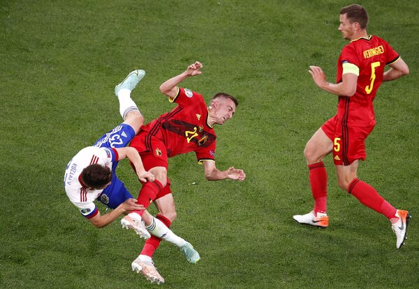 Daler Kuzyayev, left, of Russia and Timothy Castagne of Belgium left Saturday's match in the first half after a clash of heads.