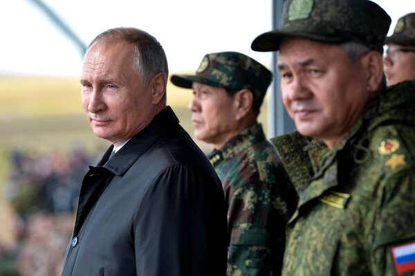 Preisdent Vladimir V. Putin with Chinese and Russian military officials in 2018.