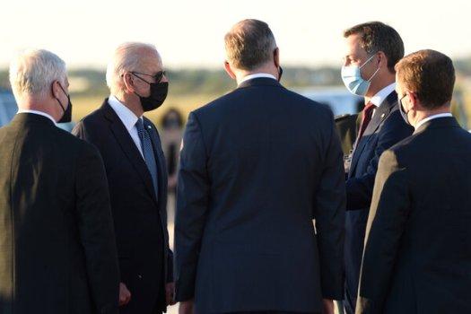 President Biden is welcomed by Prime Minister Alexander De Croo of Belgium in Brussels on Sunday.