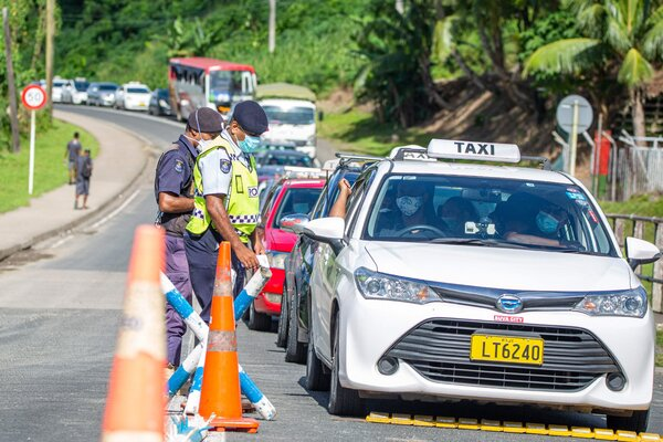 Police officers checking cars in Suva, Fiji, in late April.The island nation, with a population of about 900,000, now has more than 1,000 known active cases of the coronavirus.