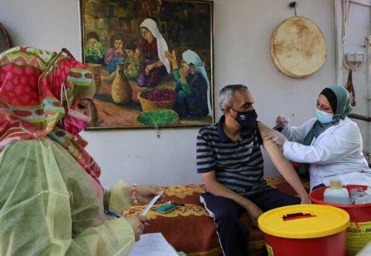 A Palestinian receiving a vaccine this month in the village of Dura, near Hebron, in the West Bank.
