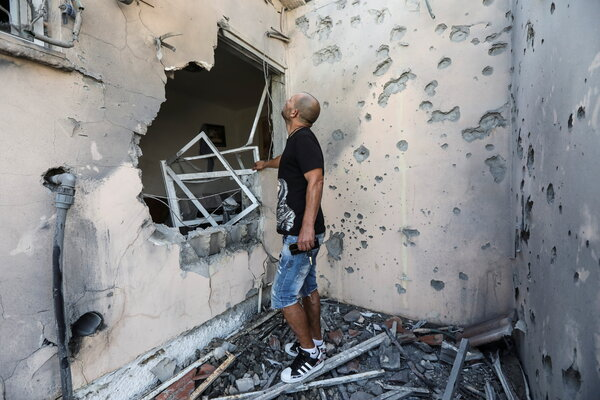Assessing the damage in Sderot, Israel, after a rocket fired from Gaza hit a house.