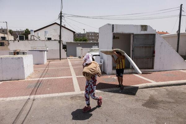 Children leaving a shelter in Ashkelon, Israel, on Friday.