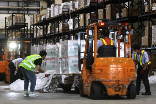 Handling Moderna vaccines shipped from the United States at a cargo depot in Taoyuan International Airport, Taiwan, this month. Washington has sent 2.5 million doses to the island, which Beijing regards as its territory.