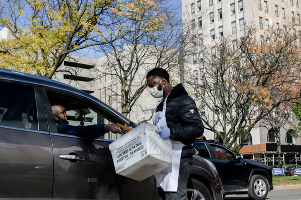 An election worker collected absentee ballots in Detroit in November. Michigan was the site of some of Trump supporters' farthest-reaching attempts to challenge the election results.