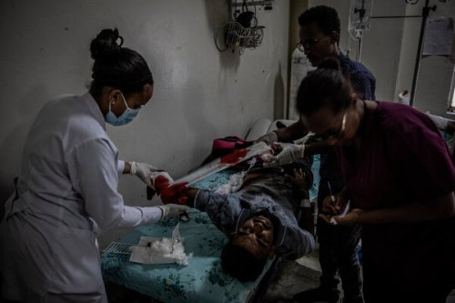 Health care workers in Mekelle treating a man who was injured Tuesday by a government airstrike on a market in the nearby town of Togoga, in Ethiopia's northern Tigray region.