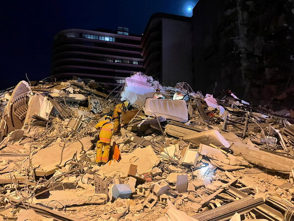 Emergency personnel work at the site of a partially collapsed building in Miami Beach, Fla., on June 24.