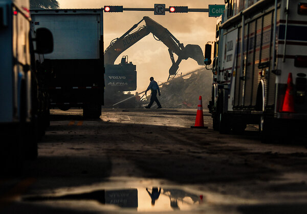 Rescuer workers used heavy equipment to remove debris as search efforts entered a third day on Saturday at the site where the Champlain Towers South collapsed in Surfside, Fla.