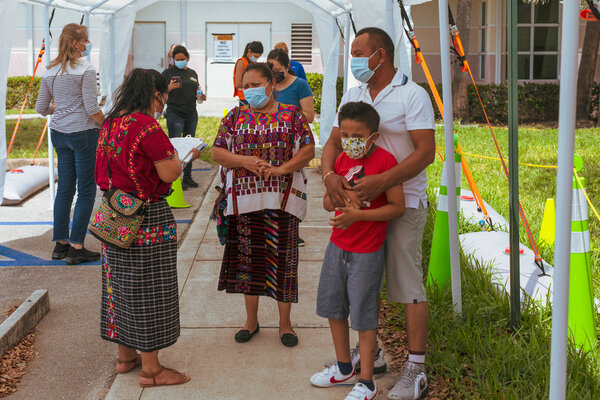Fabiana Lopez and her family in line to get vaccinated in Lake Worth, Fla., in April.