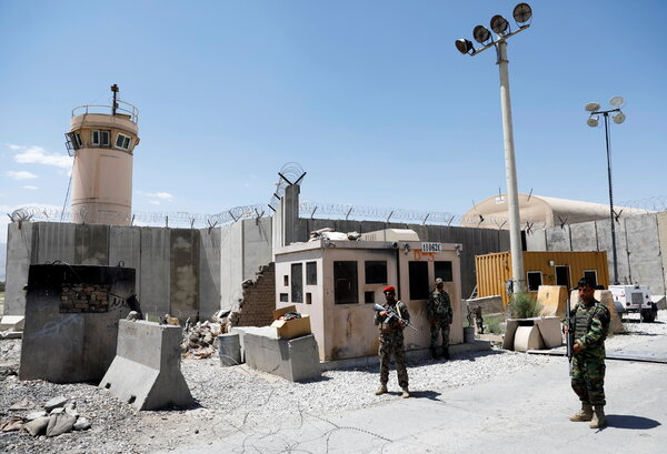 Afghan soldiers standing guard at the gate of the Bagram Air Base on Friday.