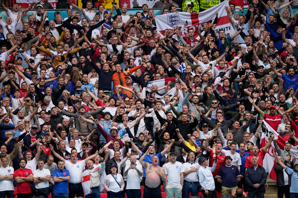 England supporters cheering in the stands of Wembley Stadium in London before the start of a European Championship soccer match against Germany last week.