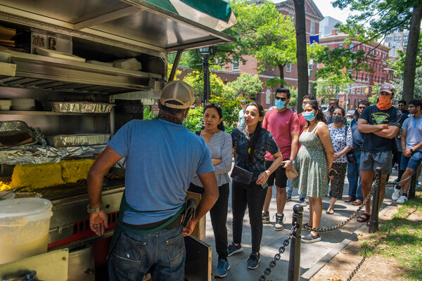 More than 50 people lined up to buy lunch from a food cart serving vegan South Indian food at Washington Square Park on Monday.