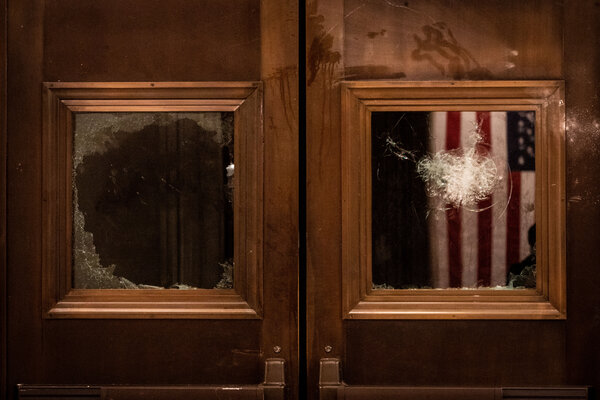 Broken glass on doors leading to the Capitol Rotunda after the Jan. 6 attack. The Lincoln Project's new campaign could offer the group a way to rebrand itself after internal disputes.