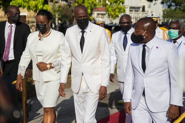 The late President Jovenel Moïse of Haiti, center, with his wife, Martine Moise, and interim Prime Minister Claude Joseph, right, at a ceremony in Port-au-Prince in May.