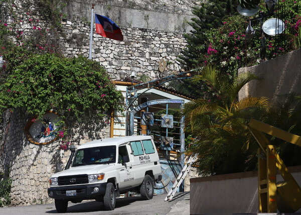 An ambulance carrying the body of President Jovenel Moise in Port-au-Prince, Haiti, on Wednesday.