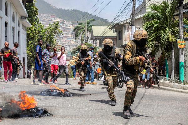 A protest on Thursday near the police station in thePétionville suburb of Port-au-Prince, Haiti.