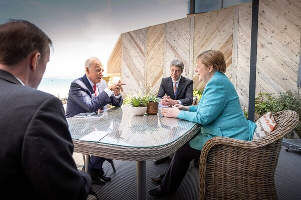 Chancellor Angela Merkel and President Biden talking at the Group of 7 summit in England last month. They have known each other for years.