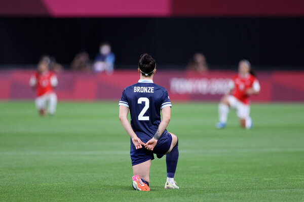 Lucy Bronze of Britain took a knee before a match with Chile in Sapporo.