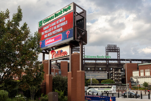 The bad news for baseball fans, posted outside the ballpark in Philadelphia on Wednesday. The Phillies-Nationals game was postponed by a Covid-19 outbreak.
