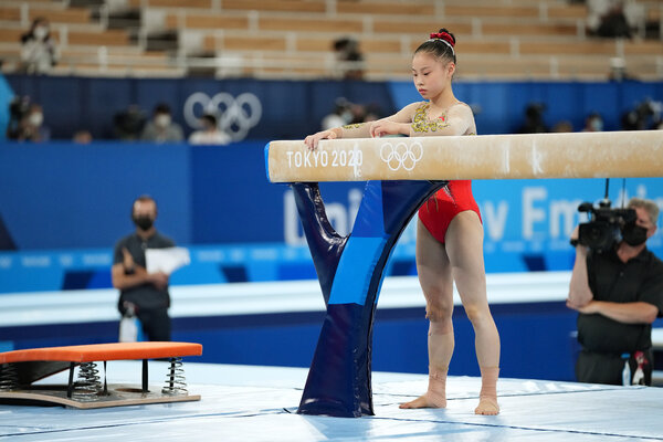 Guan Chenchen of China preparing for her balance beam routine. She won gold in the event.