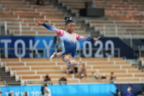 Simone Biles rose high above the beam as she performed a leap during the beam final, her last event of the Tokyo Games.