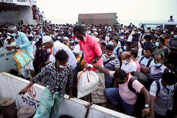 Disembarking from a ferry to return to work in central Bangladesh on Tuesday.