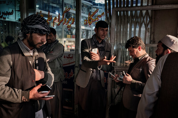 Selling phones and SIM cards at a market in Kabul, Afghanistan, in 2016.