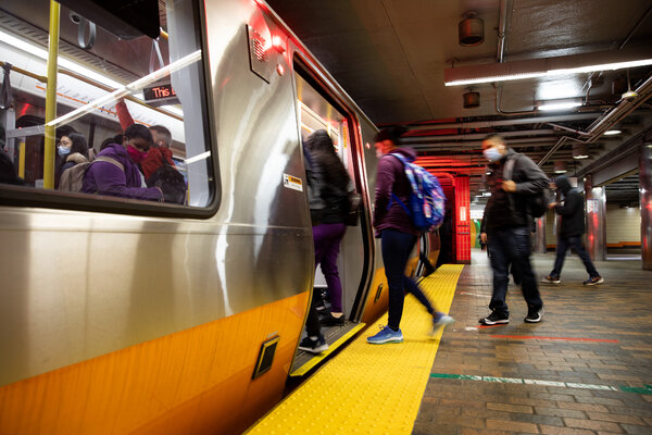 Subway riders entered an MBTA train in Boston in 2020.
