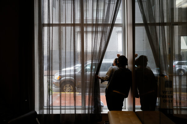 Guests rode out Hurricane Ida at the AC Hotel in New Orleans on Sunday as the storm lashed the city with wind and rain.