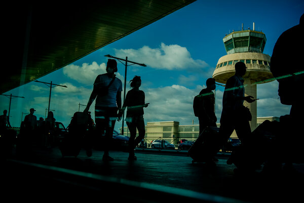 Passengers carried luggage at the Barcelona airport, Spain, Friday, July 9, 2021.