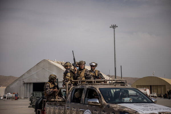 Members of the Taliban Badri 313 battalion on Tuesday at the airport in Kabul.