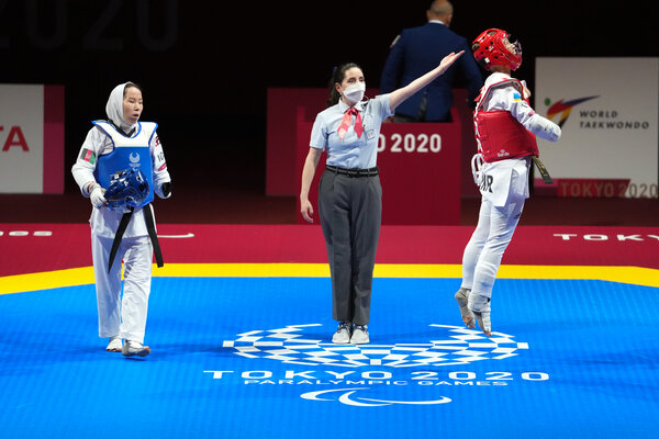 Zakia Khudadadi of Afghanistan, in blue, during her bout with Viktoriia Marchuk of Ukraine on Thursday.