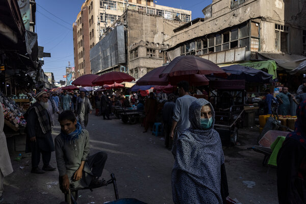 Shoppers making their way through a market in Kabul last week.