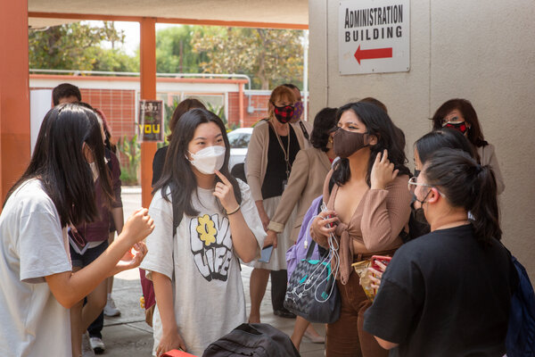 Students return to Grover Cleveland Charter Senior High School in Los Angeles.