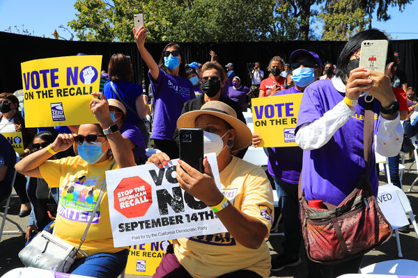 Supporters of Gov. Gavin Newsom at an event at St. Mary's Center in Oakland on Saturday.
