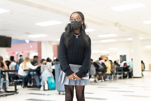 Rachel Shaw, a student in Gwinnett County, Ga., between lunch and her next class, felt safer with the mask mandate in effect at the school.